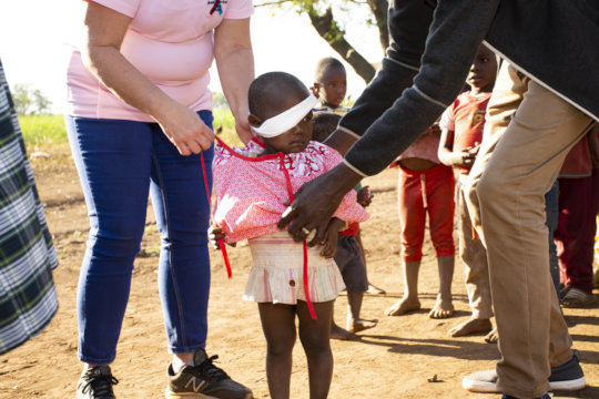 Young Aphiwe receiving new clothes