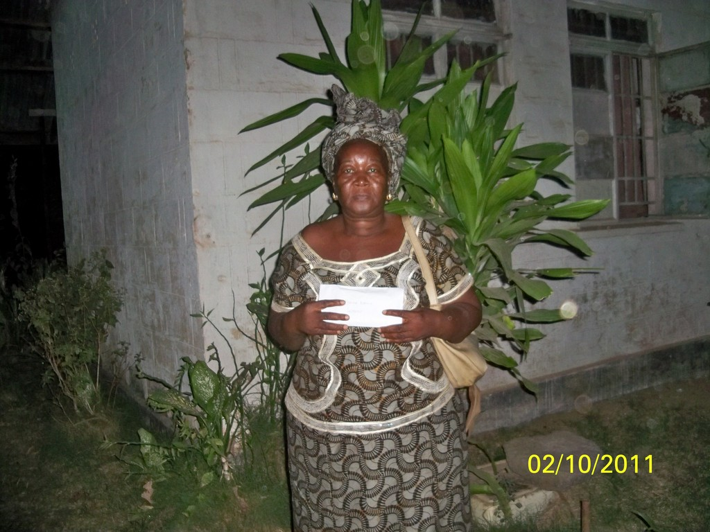 Catherine receives her microfinance funds