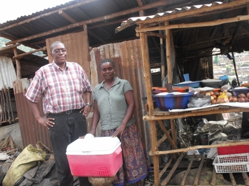 Sylvester visiting with Fatmata, one of our beneficiaries