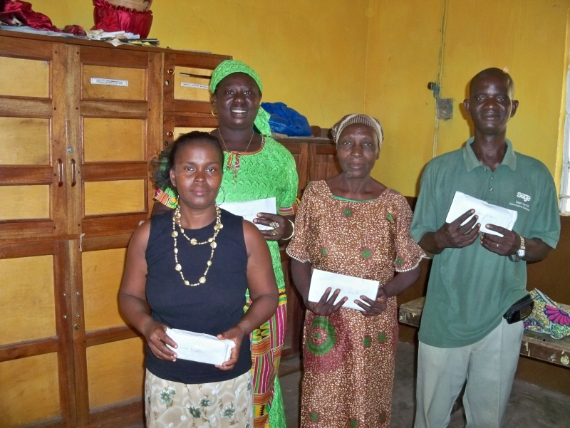 Peter and other microfinance beneficiaries