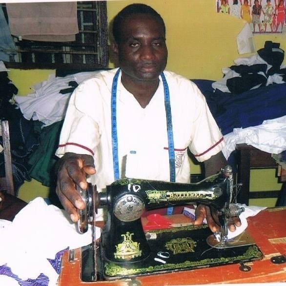 Microfinance beneficiary uses sewing machine