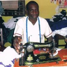 Microfinance beneficiary uses sewing machine
