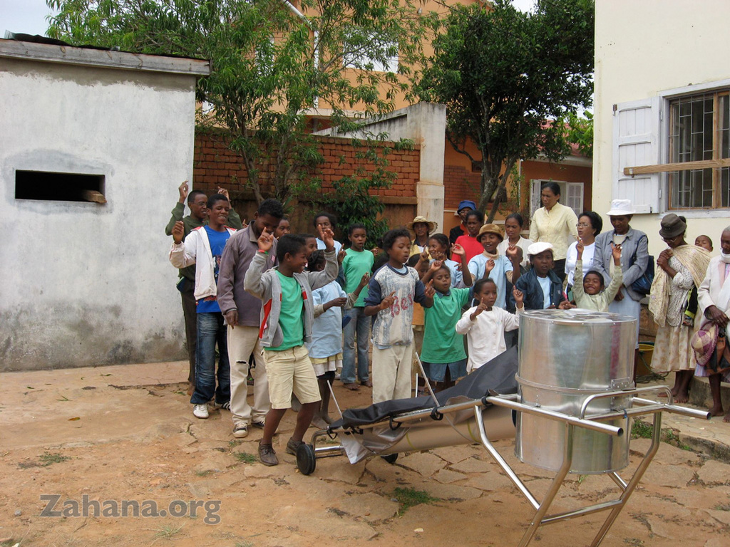 The BlazinTubeSolar cooker being assembled with an