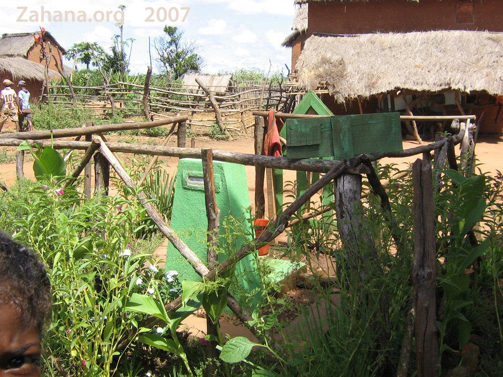 Communal water faucet keeps the garden green