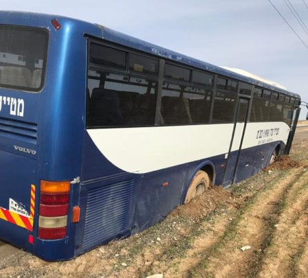 School bus stuck in mud on the Al-Fur'a road