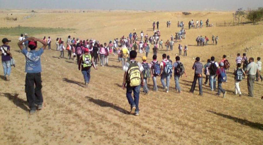 Children walking to school in the Naqab desert