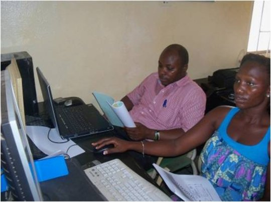 2 young adults learning MS Word and Excel