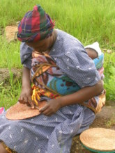 Basket weaver with child in Swaziland