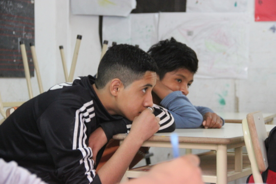 Gustavo and Axel listening during the workshop