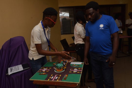Girls demonstrating electronics project
