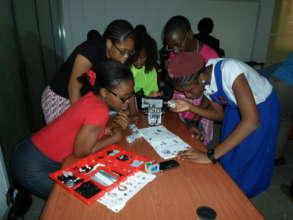Girls building robots