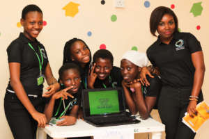 Girls from the W.TEC Camp show off their project.