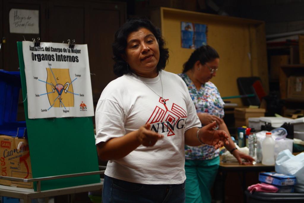WINGS nurse explains Cervical Cancer at a clinic
