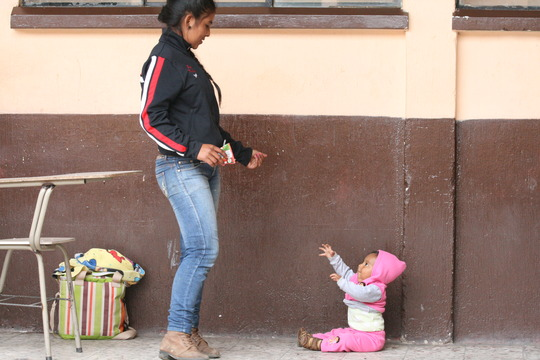 Young woman waits with her daughter