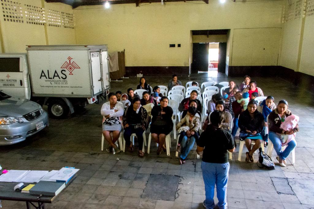 Nurse Alexia talks to patients in Alotenango