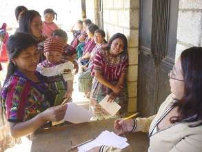 Women lined up at a mobile clinic