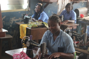Students working in tailoring class