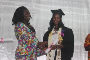 Susan graduating as a cosmetologist
