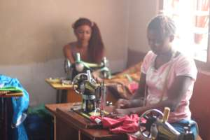 Girls in tailoring school