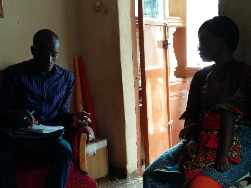 Joseph, Program Officer Talking to Zainab