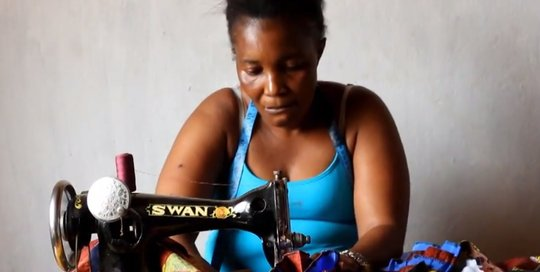 Mariama sews her special dress