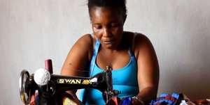 Mariama sews her special dress