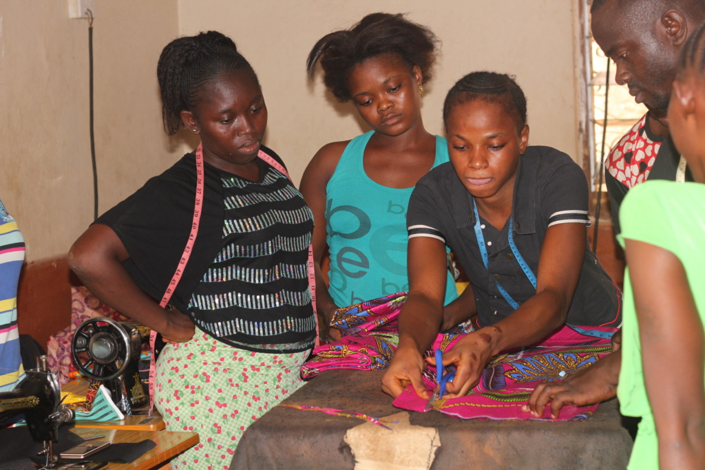 Trainee cuts cloth for first time