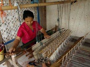 A Laos women weaver hard at work