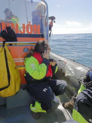 A volunteer listens for whale calls