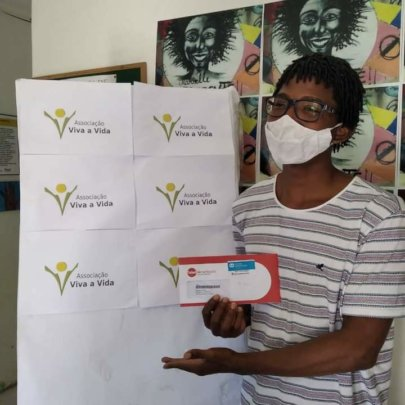 Young beneficiary receives a food voucher