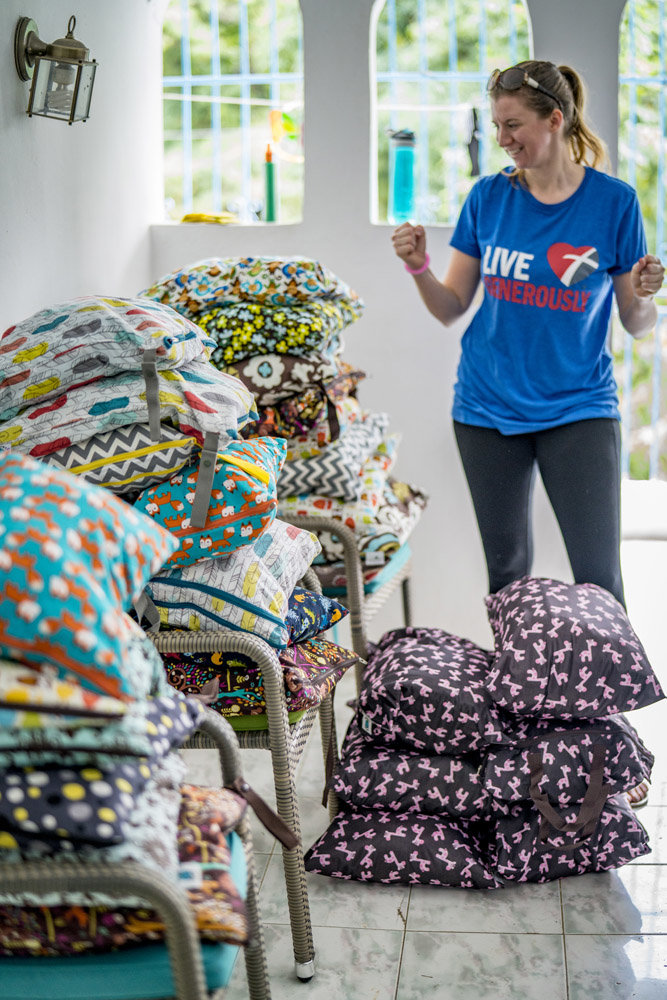 Nicole and stacks of cloth diaper kits!