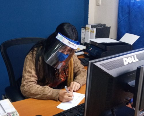 Deysi Working with her PPE in Place