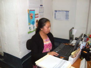 Mayra at work in the accounting office