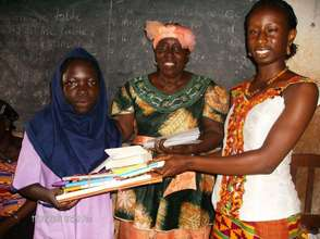 Student receiving scholarship and supplies