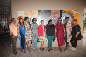 Celebrities unveiling the finished mural work.