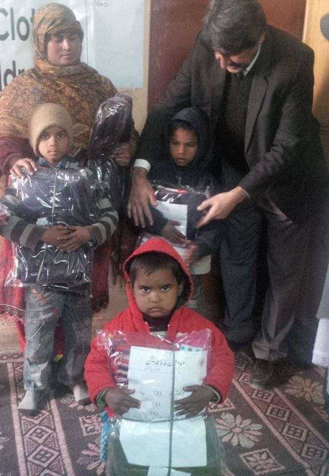 Distribution of warm clothes to children