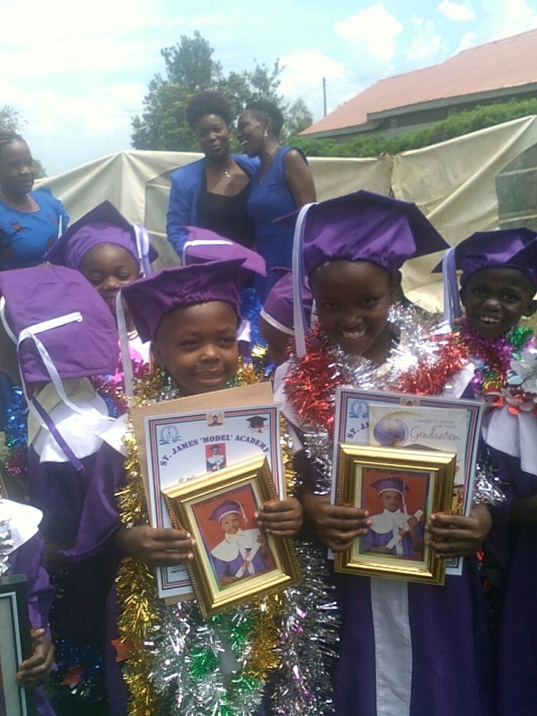 Zainabu with the certificates!!!