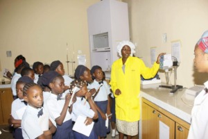 Students being lectured on the chemical processes.