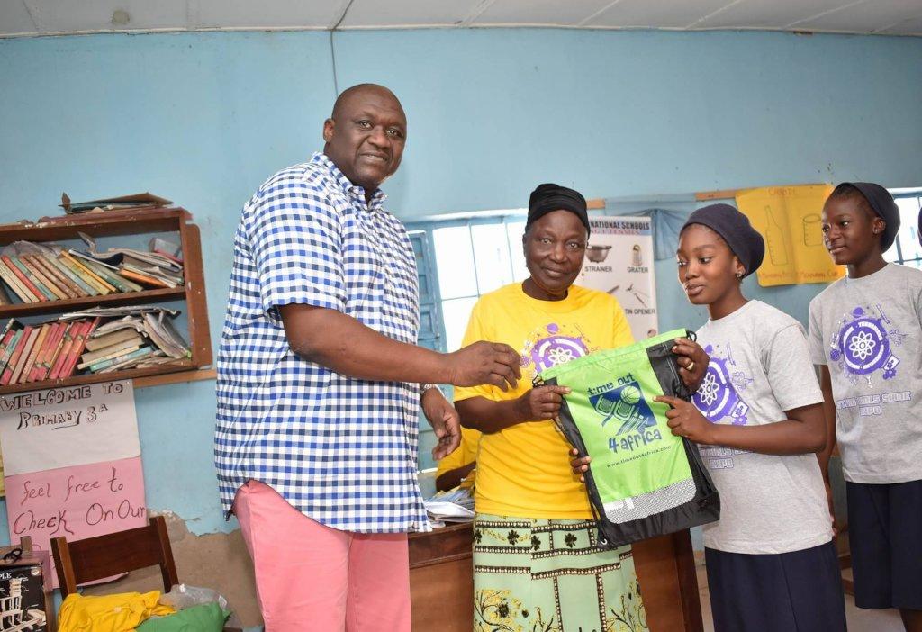 Gift bag presentation with Mr Kolo and principal.