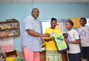 Gift bag presentation with Mr Kolo and principal.