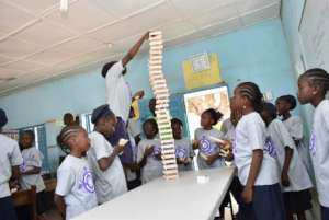 Kids in action building with Kiva blocks.