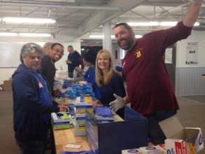 Ford Motor Company employees assembling kits
