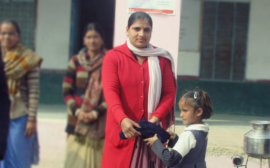 Distributed Woollen Dress to Needy Girl child