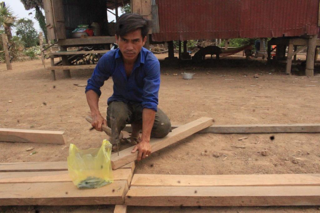Mr. Chan building his own latrine
