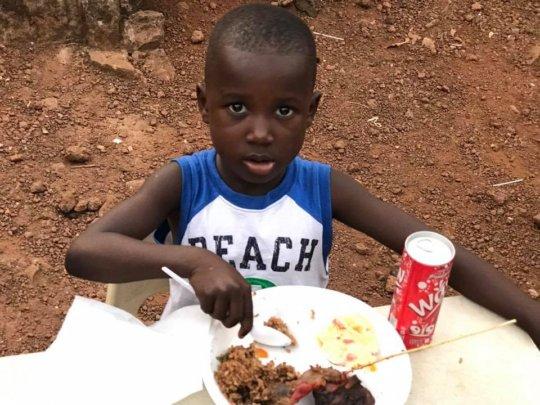 Dream Home child, Derick, enjoying a meal