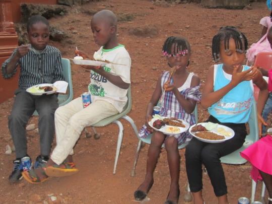 Dream Home children enjoying a meal