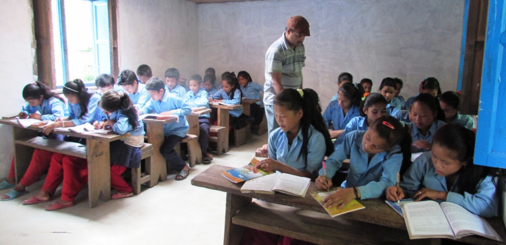 Children in classroom in Mukli Village