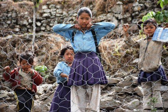 Building 10 classrooms for 500 students in Nepal.