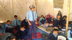 Children studying at temporary learning center