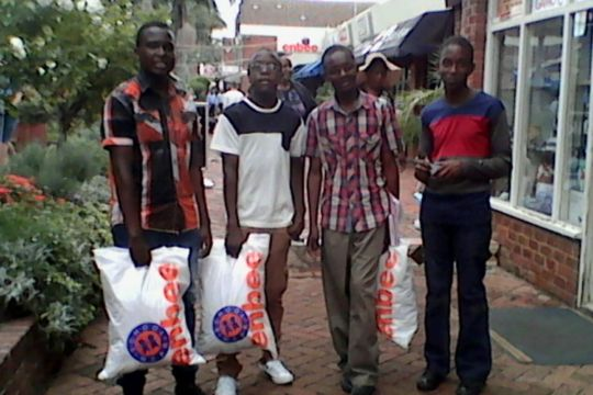 A few new students buying their school uniforms